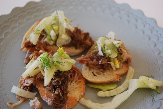 Fennel crusted pulled pork with fennel and lemon on bruschetta